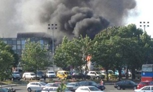 Smoke is seen after a blast at Bulgaria's Burgas airport